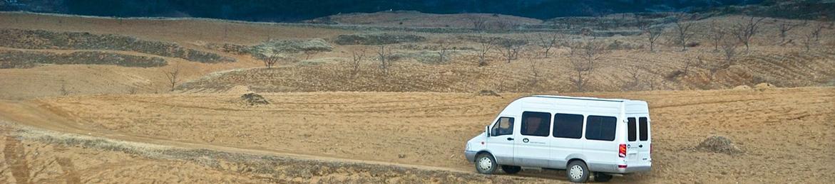 Van driving on road